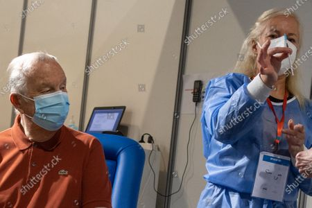 Belgian King Albert II (L) is vaccinated against COVID-19 at a vaccination center in Brussels, Belgium, 18 March 2021.
