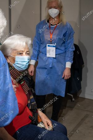 Belgian Queen Paola (C) is vaccinated against COVID-19 at a vaccination center in Brussels, Belgium, 18 March 2021.