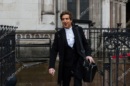 Stock Photo of LONDON, UNITED KINGDOM - MARCH 18, 2021: Johnny Depp's barrister David Sherborne leaves the Royal Courts of Justice as he applied for permission to appeal, and to rely on further evidence in a bid to overturn last year's ruling in the libel claim against The Sun and its publisher News Group Newspapers over an article labelling him a wife beater, on 18 March, 2021 in London, England. The ruling by a High Court judge Mr Justice Nicol following a three-week trial in July last year found that the claims in the article were substantially true and that the US actor had assaulted his ex-wife Amber Heard.