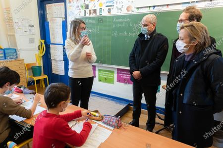A teacher, Jean-Michel Blanquer, Gille Legendre, and Florence Berthout