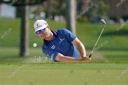 Zach Johnson hits from a bunker on the third hole during the first round of the Honda Classic golf tournament, in Palm Beach Gardens, Fla