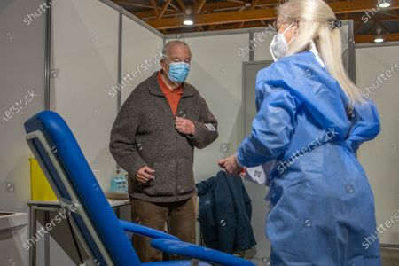 Stock Image of King Albert II and Queen Paola get their Covid-19 jab at a vaccination center.