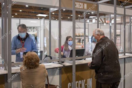 Stock Picture of King Albert II and Queen Paola get their Covid-19 jab at a vaccination center.