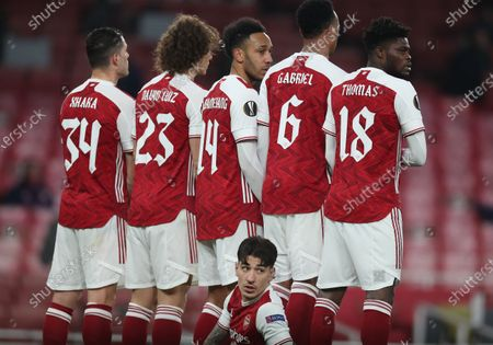 Hector Bellerin lies on the floor as his Arsenal teammates form a defensive wall