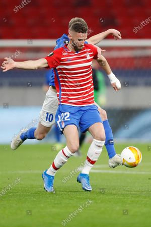 Granada's Domingos Duarte challenges for the ball with Molde's Bjorn Bergmann Sigurdarson during the Europa League, round of 16, second leg soccer match, between Granada and Molde FK at the Puskas Arena stadium in Budapest, Hungary