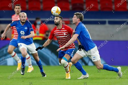 Granada's Maxime Gonalons, left, challenges for the ball with Molde's Bjorn Bergmann Sigurdarson during the Europa League, round of 16, second leg soccer match, between Granada and Molde FK at the Puskas Arena stadium in Budapest, Hungary