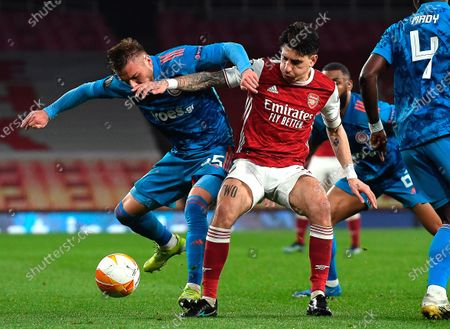 Arsenal's Hector Bellerin (R) in action against Olympiacos' Oleg Reabciuk (L) during the UEFA Europa League round of 16, second leg soccer match between Arsenal FC and Olympiacos Piraeus in London, Britain, 18 March 2021.
