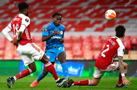Olympiacos' Bruma (C) in action against Arsenal players Thomas Partey (L) and Hector Bellerin (R) during the UEFA Europa League round of 16, second leg soccer match between Arsenal FC and Olympiacos Piraeus in London, Britain, 18 March 2021.