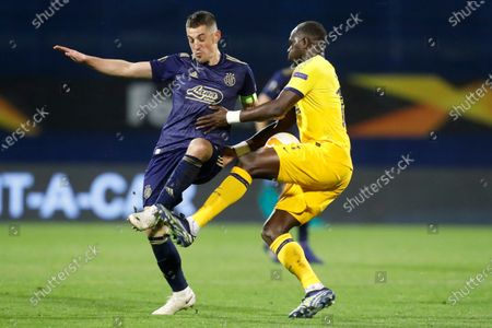 Dinamo Zagreb's Arijan Ademi, left, fights for the ball with Tottenham's Moussa Sissoko during the Europa League round of 16 second leg soccer match between Dinamo Zagreb and Tottenham Hotspur at the Maksimir stadium in Zagreb, Croatia