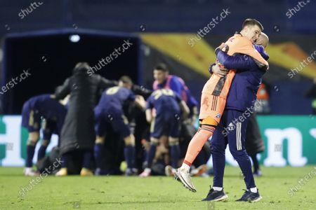 Dinamo Zagreb's goalkeeper Dominik Livakovic, second right, celebrates after his teammate Mislav Orsic scores his side's third goal during the Europa League round of 16 second leg soccer match between Dinamo Zagreb and Tottenham Hotspur at the Maksimir stadium in Zagreb, Croatia