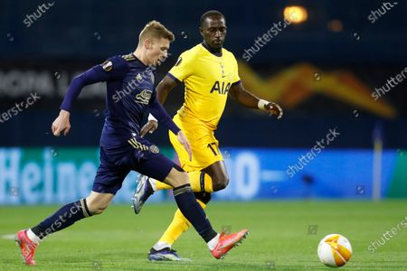 Dinamo Zagreb's Luka Ivanusec, left, attempts a shot at goal in front of Tottenham's Moussa Sissoko during the Europa League round of 16 second leg soccer match between Dinamo Zagreb and Tottenham Hotspur at the Maksimir stadium in Zagreb, Croatia