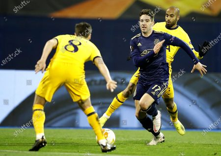 Luka Ivanusec (R) of Zagreb in action against Harry Winks (L) of Tottenham during the UEFA Europa League Round of 16, second leg match between Dinamo Zagreb and Tottenham Hotspur in Zagreb, Croatia, 18 March 2021.