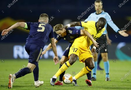 Lovro Majer (C) of Zagreb in action against Moussa Sissoko (R) of Tottenham during the UEFA Europa League Round of 16, second leg match between Dinamo Zagreb and Tottenham Hotspur in Zagreb, Croatia, 18 March 2021.