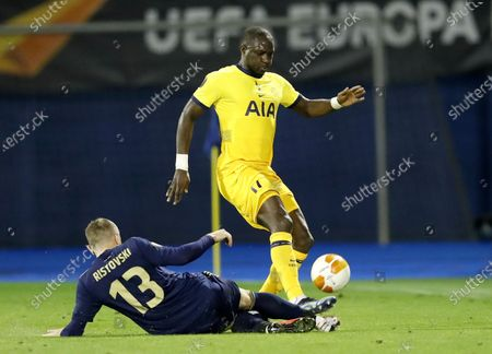 Moussa Sissoko (R) of Tottenham in action against Dinamo's Stefan Ristovski(L) during the UEFA Europa League Round of 16, second leg match between Dinamo Zagreb and Tottenham Hotspur in Zagreb, Croatia, 18 March 2021.