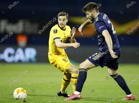 Sadegh Moharrami (R) of Zagreb in action against Harry Winks (L) of Tottenham during the UEFA Europa League Round of 16, second leg match between Dinamo Zagreb and Tottenham Hotspur in Zagreb, Croatia, 18 March 2021.