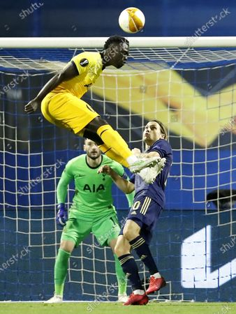 Stock Image of Davinson Sanchez (L) of Tottenham in action against Dinamo's Lovro Majer (R) during the UEFA Europa League Round of 16, second leg match between Dinamo Zagreb and Tottenham Hotspur in Zagreb, Croatia, 18 March 2021.