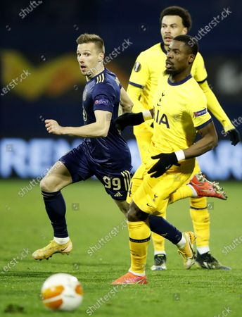 Davinson Sanchez (R) of Tottenham in action against Dinamo's Mislav Orsic (L) during the UEFA Europa League Round of 16, second leg match between Dinamo Zagreb and Tottenham Hotspur in Zagreb, Croatia, 18 March 2021.