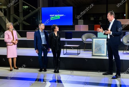 Ugur Sahin (2-L) and his wife Ozlem Tureci (2-R), the founders of the Mainz-based corona vaccine developer Biontech with publisher Friede Springer (L) and CEO of Axel Springer SE Mathias Doepfner (R) at an Axel Springer Award ceremony in Berlin, Germany, 18 March 2021. The winners are being honored 'for their entrepreneurial spirit, innovative strength and sense of social responsibility'. The Axel Springer Award honors outstanding personalities who are innovative in a special way, create and change markets, shape culture and at the same time face up to their social responsibility.