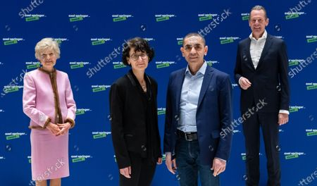 Ugur Sahin (2-R) and his wife Ozlem Tureci (2-L), the founders of the Mainz-based corona vaccine developer Biontech, are welcomed by publisher Friede Springer (L) and CEO of Axel Springer SE Mathias Doepfner (R), at an Axel Springer Award ceremony in Berlin, Germany, 18 March 2021. The winners are being honored 'for their entrepreneurial spirit, innovative strength and sense of social responsibility'. The Axel Springer Award honors outstanding personalities who are innovative in a special way, create and change markets, shape culture and at the same time face up to their social responsibility.