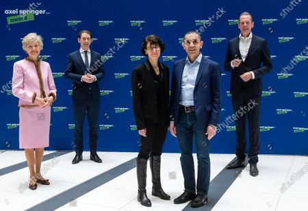 Stock Photo of Ugur Sahin (2-R) and his wife Ozlem Tureci (C), the founders of the Mainz-based corona vaccine developer Biontech, and the laudator, Austrian Chancellor Sebastian Kurz (2-L) are welcomed by publisher Friede Springer (L) and CEO of Axel Springer SE Mathias Doepfner (R), at an Axel Springer Award ceremony in Berlin, Germany, 18 March 2021. The winners are being honored 'for their entrepreneurial spirit, innovative strength and sense of social responsibility'. The Axel Springer Award honors outstanding personalities who are innovative in a special way, create and change markets, shape culture and at the same time face up to their social responsibility.