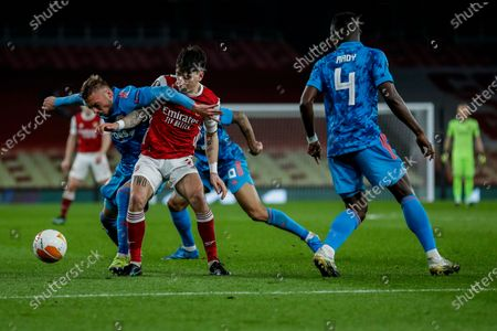 Arsenal's Hector Bellerin duels for the ball with Olympiaco's Oleg Reabciuk, left, during the Europa League, round of 16, second leg soccer match between Arsenal and Olympiacos at the Emirates Stadium, in London