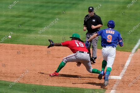 Washington Nationals first baseman Josh Bell (19) takes the throw as New York Mets' Brandon Nimmo (9) is out during a spring training baseball game, in Port St. Lucie, Fla