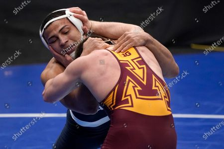 Penn State's Aaron Brooks, left, takes on Minnesota's Owen Webster during their 184-pound match in the second round of the NCAA wrestling championships, in St. Louis