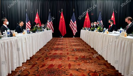 Secretary of State Antony Blinken, second from right, joined by national security adviser Jake Sullivan, right, speaks while facing Chinese Communist Party foreign affairs chief Yang Jiechi, second from left, and China's State Councilor Wang Yi, left, at the opening session of US-China talks at the Captain Cook Hotel in Anchorage, Alaska