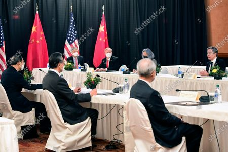 Secretary of State Antony Blinken, speaks as Chinese Communist Party foreign affairs chief Yang Jiechi, left, and China's State Councilor Wang Yi, second from left, listen at the opening session of US-China talks at the Captain Cook Hotel in Anchorage, Alaska