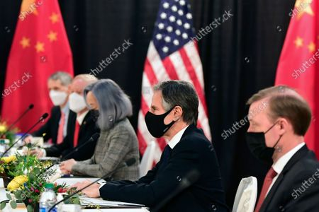 Secretary of State Antony Blinken, second from right, joined by national security adviser Jake Sullivan, right, listen as they meeti Chinese Communist Party foreign affairs chief Yang Jiechi and China's State Councilor Wang Yi at the opening session of US-China talks at the Captain Cook Hotel in Anchorage, Alaska