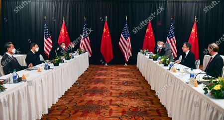 Secretary of State Antony Blinken, second from right, joined by national security adviser Jake Sullivan, right, speaks during the opening session of US-China talks with Chinese Communist Party foreign affairs chief Yang Jiechi, and China's State Councilor Wang Yi, at the Captain Cook Hotel in Anchorage, Alaska