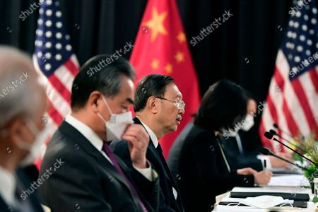 Chinese Communist Party foreign affairs chief Yang Jiechi, center, and China's State Councilor Wang Yi, second from left, speak at the opening session of US-China talks at the Captain Cook Hotel in Anchorage, Alaska