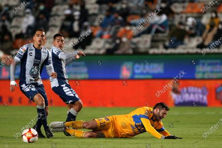 Stock Picture of Luis Chavez (L) and Erick Sanchez (2-L) of Pachuca in action against Andre Pierre Gignac (R) of Tigres UANL during the Liga MX 2021 Guardianes Clausura tournament soccer match between Pachuca and Tigres UANL at the Hidalgo Stadium in Pachuca, Mexico, 18 March 2021.
