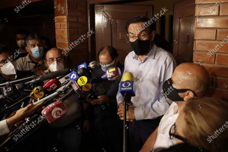 Former Peruvian President Martin Vizcarra (C) speaks to the press after being released on bail of 100,000 soles (about 27,000 US  dollar) while the alleged bribes received when he was Governor of the southern region of Moquegua (2011-2014) are investigated, in Lima, Peru, 18 March 2021. Vizcarra, accused of the crimes of passive bribery, aggravated collusion and illicit association to commit a crime, may continue his electoral campaign in the streets as a candidate for Congress, but obliged to appear before the court once a month, request permission to leave Lima and prevented from leaving Peru.