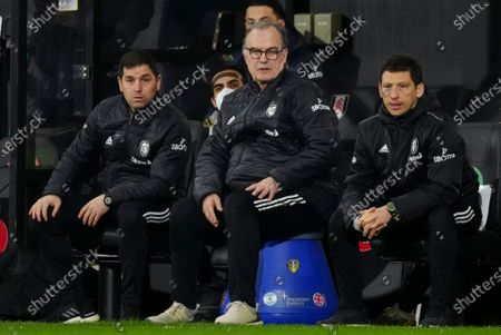 Stock Image of Marcelo Bielsa Leeds United Manager sits alongside his assistants Andres Clavijo and Diego Reyes