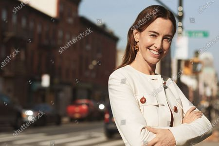 Author Jancee Dunn in a Brock Collection coat and Anissa Kermiche earrings, photographed in Brooklyn. Jancee Dunn
