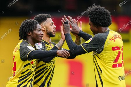 Andre Gray of Watford celebrates scoring a goal with Joseph Hungbo of Watford and Carlos Sanchez of Watford to make it 3-0