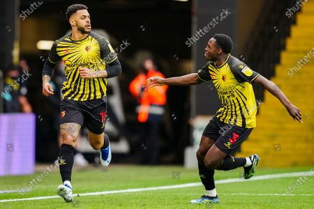 Andre Gray of Watford celebrates scoring a goal with Jeremy Ngakia of Watford to make it 3-0