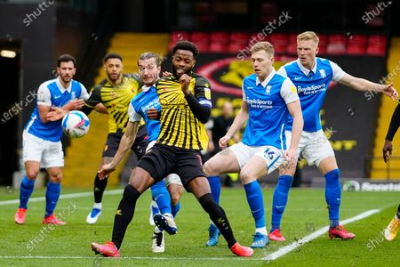 Nathaniel Chalobah of Watford attempts to control the ball while under pressure from Josh McEachran of Birmingham City