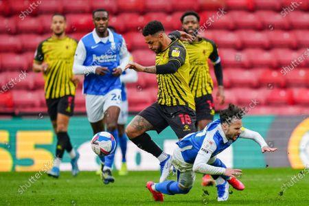 Stock Image of Andre Gray of Watford runs the ball past Ivan Sanchez of Birmingham City