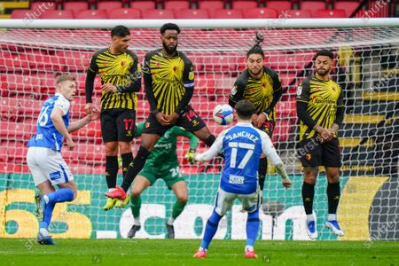 Nathaniel Chalobah of Watford attempts to block a free kick by Ivan Sanchez of Birmingham City