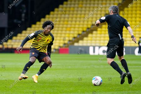 Referee Darren Bond gets in the way of the ball as Carlos Sanchez of Watford attempts to navigate around