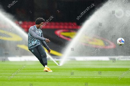 Carlos Sanchez of Watford warms up in front of the water sprinklers before kick off
