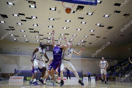 Forward Nathan Adrian (C) of MBC Mykolaiv is seen in action with power forward Jervon Pressley (L) and centre Ihor Chumakov (R) of BC Kharkivski Sokoly during the 2020/2021 Ukrainian Basketball SuperLeague Round 29 match in Kharkiv, northeastern Ukraine.