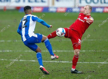 David Morgan of Accrington Stanley and Funso Ojo of Wigan Athletic
