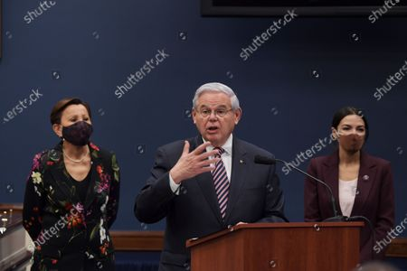 Senator Bob Menndez(D-NJ) alongside Congresswoman Nydia Velzquez(D-NY)(left)  and Alexandria Ocasio Cortez(D-NY)(right) speaks during a press conference about bicameral introduction of the Puerto Rico Self-Determination Act of 2021, today on March 18, 2021 at Rayburn HOB/Capitol Hill in Washington DC, USA.