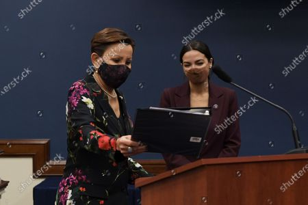 Congresswoman Nydia Velzquez(D-NY) and Alexandria Ocasio Cortez(D-NY) talk to each other during a press conference about bicameral introduction of the Puerto Rico Self-Determination Act of 2021, today on March 18, 2021 at Rayburn HOB/Capitol Hill in Washington DC, USA.