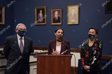 Congresswoman Alexandria Ocasio Cortez(D-NY)(center) alongside Nydia Velzquez(D-NY) and Senator Bob Menndez(D-NJ) speaks during a press conference about bicameral introduction of the Puerto Rico Self-Determination Act of 2021, today on March 18, 2021 at Rayburn HOB/Capitol Hill in Washington DC, USA.