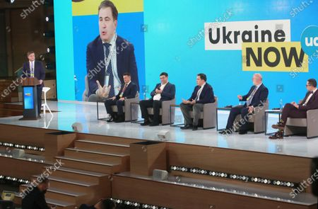 Deputy Chief of Party at USAID Competitive Economy Program (CEP) in Ukraine, moderator Liubomyr Chornii, head of the State Fiscal Service of Ukraine Vadym Melnyk, deputy head of the State Tax Service of Ukraine Yevhen Oleinikov, head of the Executive Committee of the National Reforms Council of Ukraine Mikheil Saakashvili, president of the Association of Taxpayers of Ukraine, Ambassador Extraordinary and Plenipotentiary of Georgia to Ukraine (2009-2013) Grigol Katamadze and Deputy Business Ombudsman Yaroslav Gregirchak (L to R) attend the Tax Office Reform: Optimal Model session on Day Three at the Ukraine 30. Small and Medium Business and the State Forum at the Parkovy Kyiv International Convention Center, Kyiv, capital of Ukraine.
