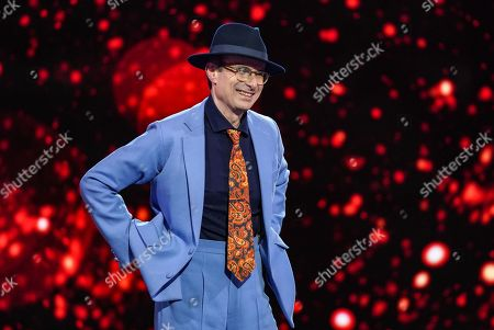 Stock Photo of Robert Peston performs Luck be A Lady from Guys and Dolls.